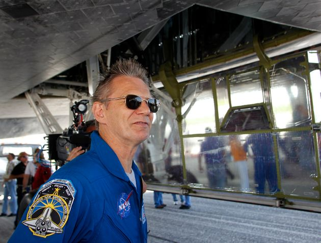 Piers Sellers, who was born in England, of the space shuttle Atlantis, looks at the orbiter after landing...
