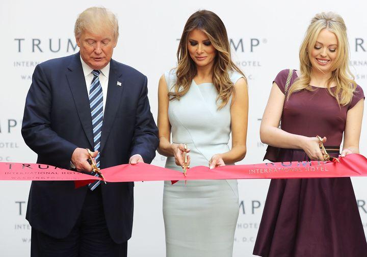 President-electDonald Trump, Melania Trump and his daughter Tiffany Trump cut the ribbon at the new Trump International