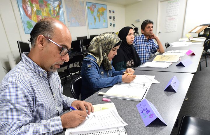 Syrian refugees take notes during their Vocational ESL class at the International Rescue Committee center in San Diego on Aug
