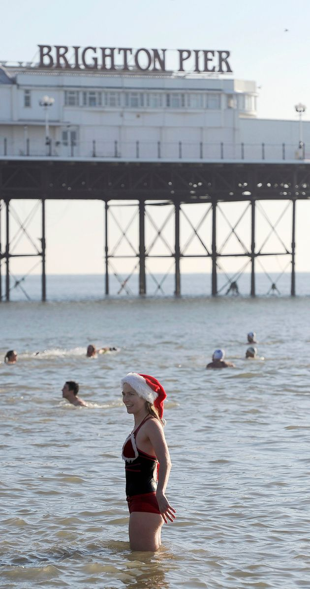A swimmer takes to the sea for a Christmas Day dip on Brighton Beach in