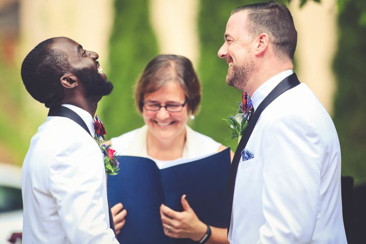 Eric and David share a laugh during their July 2016 wedding ceremony.