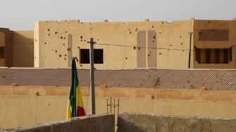 Bullet holes are seen in a police station in Gao, Mali, August 11, 2015. The United Nations has deployed 10,000 peacekeepers and poured more than $1 billion into Mali but its efforts to end a three-year conflict are threatened by the reemergence of a centuries-old rivalry between Tuareg clans. Picture taken August 11. To match Insight MALI-VIOLENCE/MILITIA      REUTERS/Emma Farge