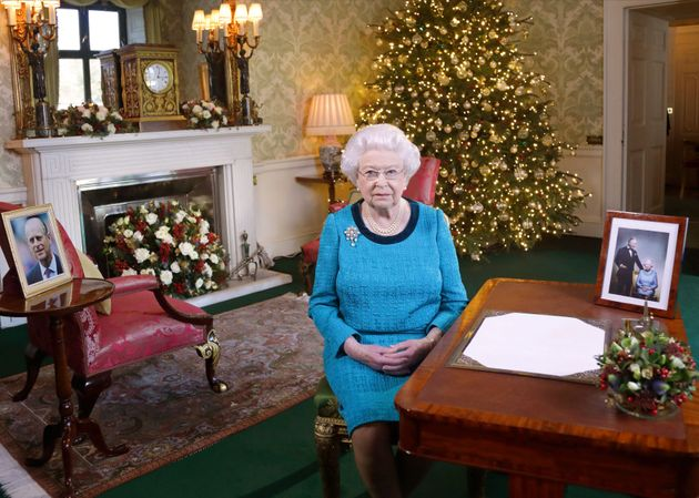 Queen Elizabeth II sits at a desk in the Regency Room in Buckingham Palace, London, after recording her...