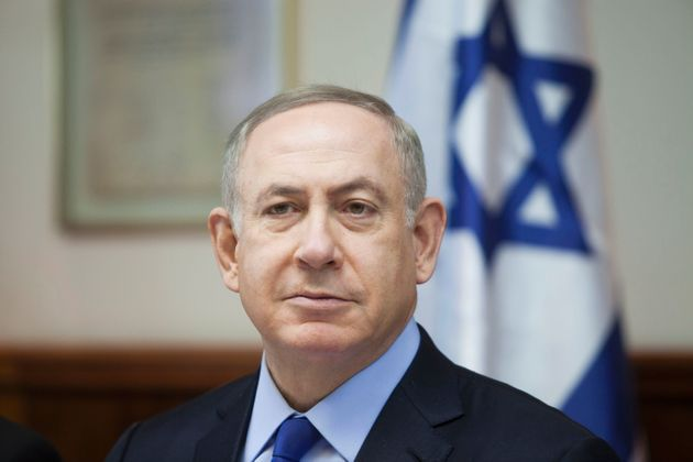 Israeli Prime Minister Benjamin Netanyahu chairs the weekly cabinet meeting in Jerusalem on December...