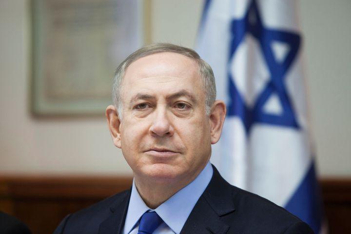 Israeli Prime Minister Benjamin Netanyahu chairs the weekly cabinet meeting in Jerusalem on December 25, 2016. Israel was def