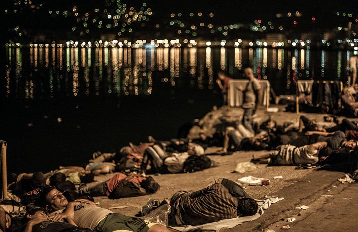 Refugees and migrants sleep outdoors on the shores of Lesbos, Greece.