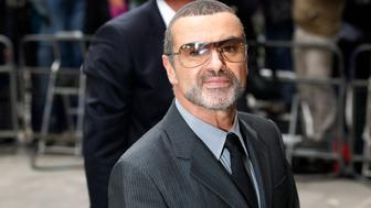 British singer George Michael arrives at Highbury Magistrates Court in London September 14, 2010. George Michael arrived to be sentenced after admitting driving under the influence of drugs and possession of cannabis, according to media reports. REUTERS/Suzanne Plunkett (BRITAIN - Tags: ENTERTAINMENT CRIME LAW)