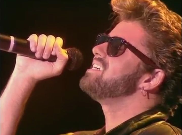 """George Michael performs """"Don't Let the Sun Go Down on Me"""" with Elton John at the 1985 Live Aid concert."""