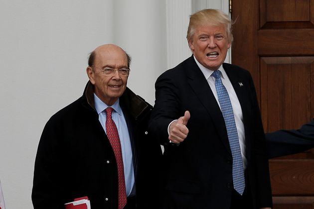 U.S. President-elect Donald Trump and greets Wilbur Ross for their meeting at Trump National Golf Club...