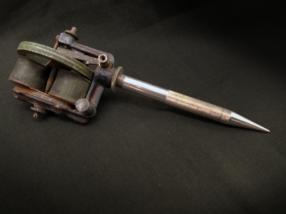 Thomas Edison, Electric pen, 1876. Nickel-plated flywheel, cast iron, steel stylus, and electric motor....