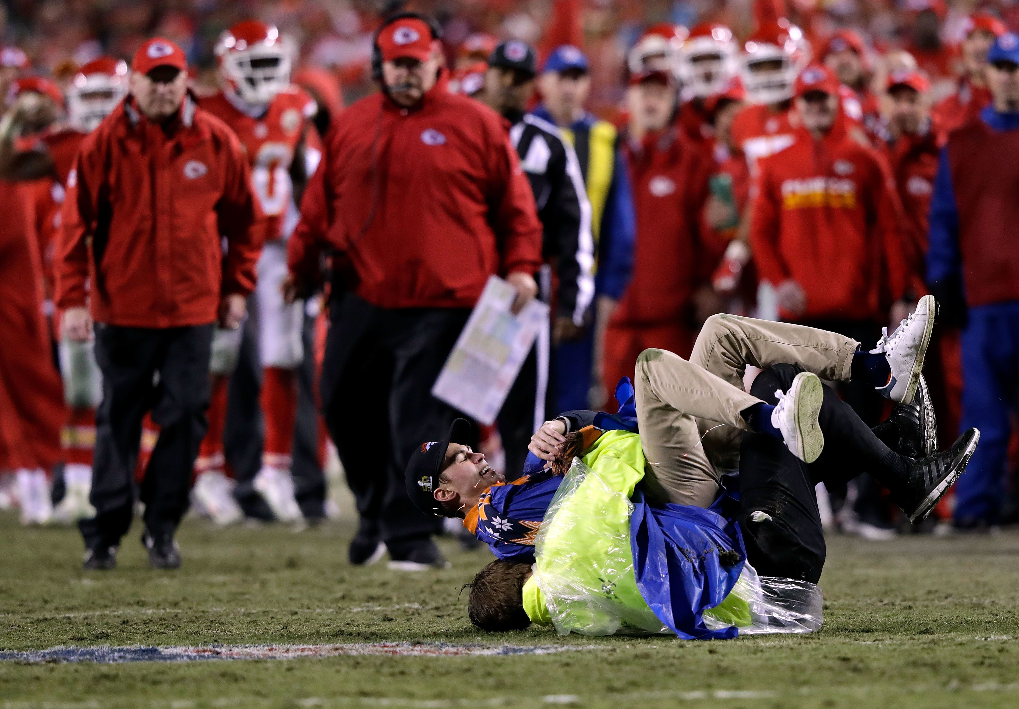 KANSAS CITY, MO - DECEMBER 25:  A fan is tackled after running onto the field during the game between the Kansas City Chiefs and the Denver Broncos at Arrowhead Stadium on December 25, 2016 in Kansas City, Missouri.  (Photo by Jamie Squire/Getty Images)
