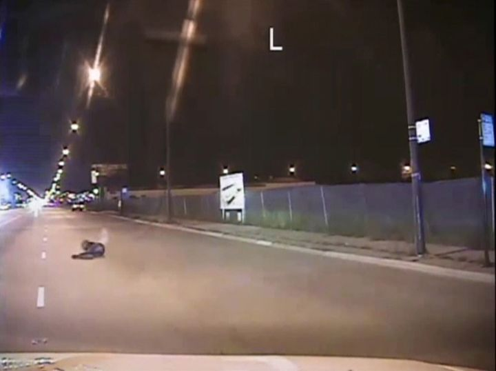 Laquan McDonald lies on a road after being shot by police officer Jason Van Dyke in Chicago, in this still image taken from a