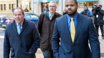 Baltimore Police Officer William Porter (R) and his attorneys Joseph Murtha (L) and Gary Proctor arrive at the courthouse for pretrial hearings in the case of Caeser Goodson in Baltimore, Maryland, January 6, 2016. A Maryland judge on Wednesday ordered Porter to testify against other officers charged in the death of detainee Freddie Gray. A lawyer for Porter said he would seek an appeals court injunction to block Porter from testifying against Officer Caesar Goodson Jr. and Sergeant Alicia White.  REUTERS/Bryan Woolston