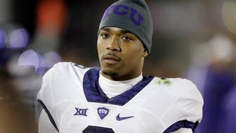 FILE - In this Oct. 17, 2015, file photo, TCU quarterback Trevone Boykin stands on the sidelines during the second half of an NCAA college football game against Iowa State in Ames, Iowa. Boykin has been charged with felony assault of a police officer. San Antonio Police spokesman Sgt. Jesse Salame said Boykin is being held on $5,000 bond. Bexar County Magistrate's website showed Boykin was arrested at early Thursday morning, Dec. 31, 2015. (AP Photo/Charlie Neibergall, File)