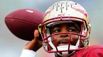 TALLAHASSEE, FL - SEPTEMBER 21:  Jameis Winston #5 of the Florida State Seminoles participates in warmups prior to a game against the Bethune-Cookman Wildcats at Doak Campbell Stadium on September 21, 2013 in Tallahassee, Florida.  Florida State won the game 54-6.  (Photo by Stacy Revere/Getty Images)