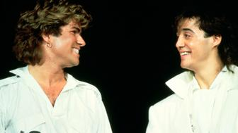 George Michael and Andrew Ridgeley of Wham! perform on stage at Sydney Entertainment Centre, Sydney, Australia, 27th January 1985. (Photo by Michael Putland/Getty Images)