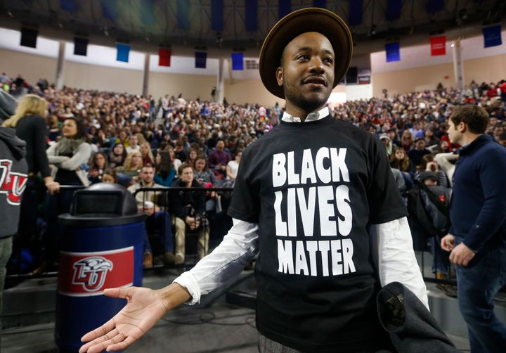 Liberty University student Jeff Long, of Washington DC., wears a Black Lives Matter t-shirt as he looks for a seat prior to a