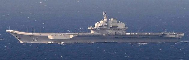 China's Kuznetsov-class aircraft carrier Liaoning sails the water in East China Sea, in this handout...