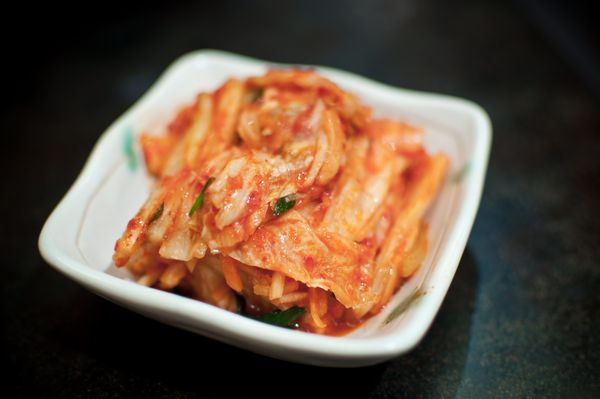 """Kimchi is just spicy, pickled cabbage, but it also happens to be the <a href=""""http://www.huffingtonpost.com/2014/12/04/kimchi"""