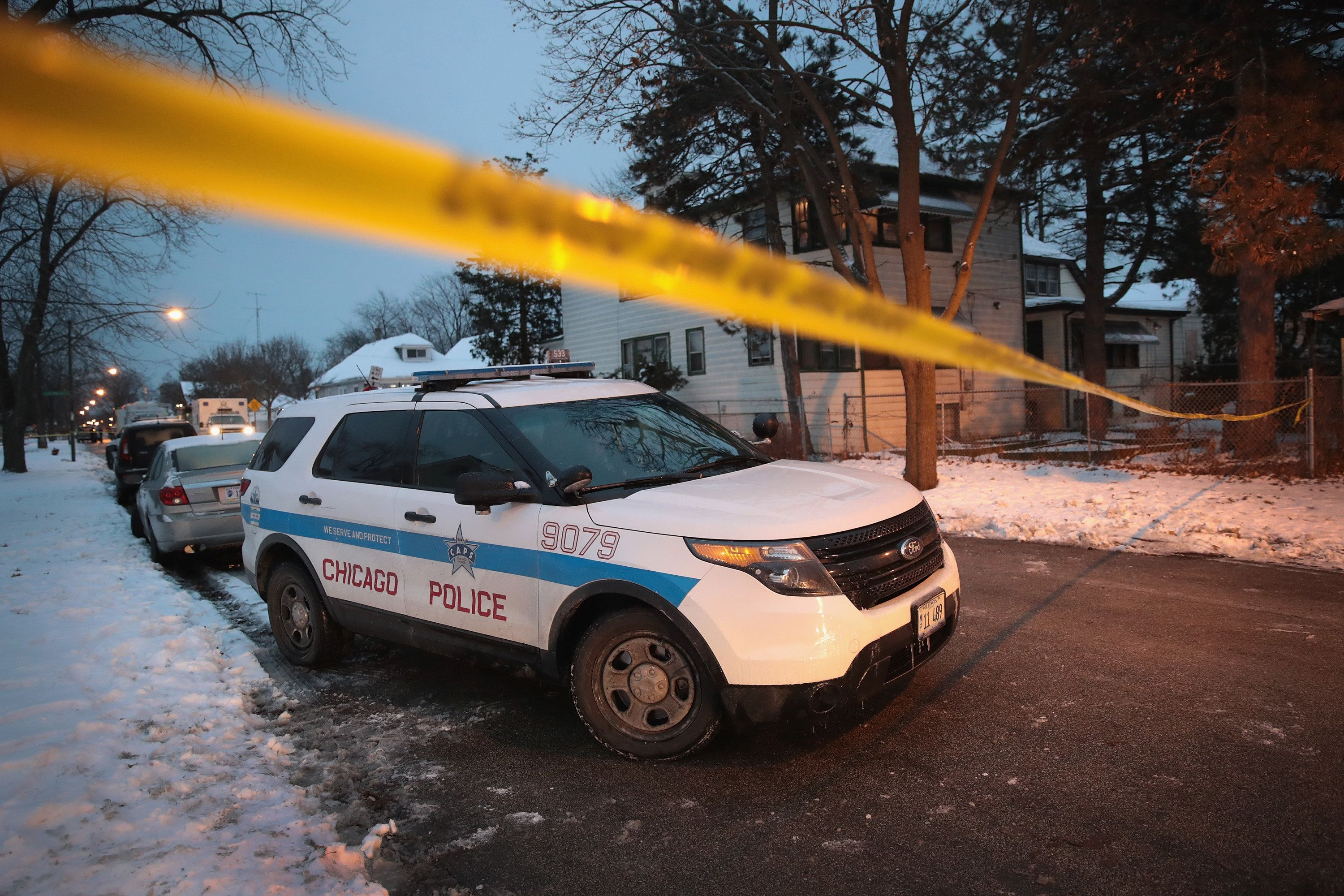 CHICAGO, IL - DECEMBER 17: Police investigate the scene of a quadruple homicide on the city's Southside on December 17, 2016 in Chicago, Illinois. Three people were found shot to death inside a home in the Fernwood neighborhood, another 2 were found shot outside the home, one of those deceased. Chicago has had more than 750 homicides in 2016. (Photo by Scott Olson/Getty Images)