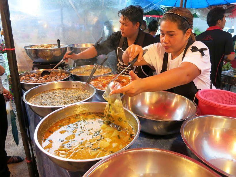 Food vendor selling curries at Sathorn market