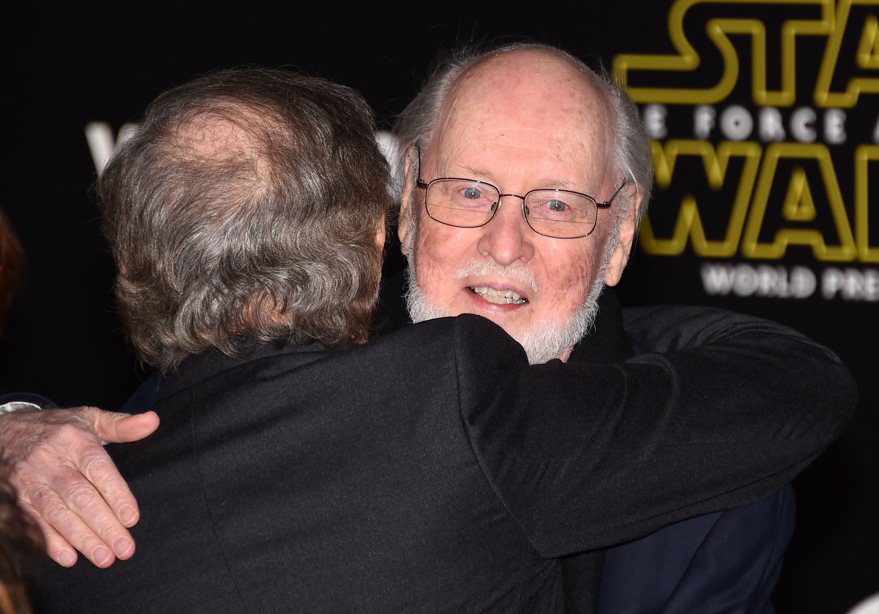 HOLLYWOOD, CA - DECEMBER 14:  Filmmaker Steven Spielberg (L) hugs composer John Williams as they attend the premiere of Walt Disney Pictures and Lucasfilm's 'Star Wars: The Force Awakens' at the Dolby Theatre on December 14, 2015 in Hollywood, California.  (Photo by Ethan Miller/Getty Images)