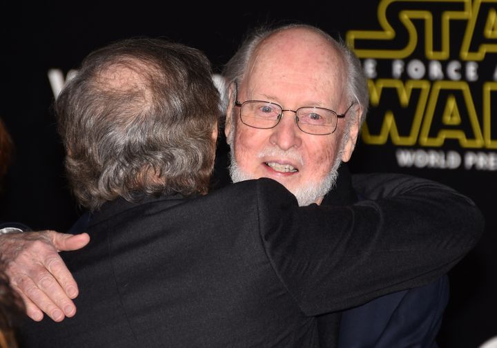 Steven Spielberg (L) hugs composer John Williams as they attend the premiere of Walt Disney Pictures and Lucasfilm's 'Star Wa