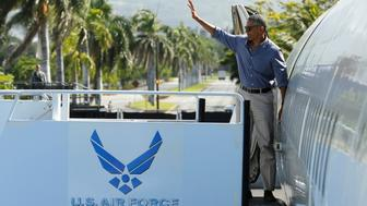 U.S. President Barack Obama boards Air Force One to depart for a visit to Papahanaumokuakea Marine National Monument at Midway Atoll, from Joint Base Pearl Harbor-Hickam, Hawaii, U.S. September 1, 2016. REUTERS/Jonathan Ernst