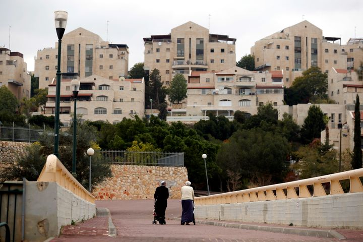 A couple walk in the Israeli settlement of Maale Edumim.
