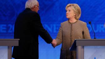 Democratic U.S. presidential candidate Senator Bernie Sanders shakes hands with rival Hillary Clinton at the conclusion of the Democratic presidential candidates debate at St. Anselm College in Manchester, New Hampshire December 19, 2015.  REUTERS/Brian Snyder
