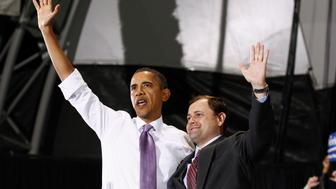 U.S. President Barack Obama and  U.S. Representative Tom Perriello (R) wave to supporters during a campaign rally for Perriello in Charlottesville, Virginia October 29,  2010.   REUTERS/Kevin Lamarque (UNITED STATES - Tags: POLITICS)