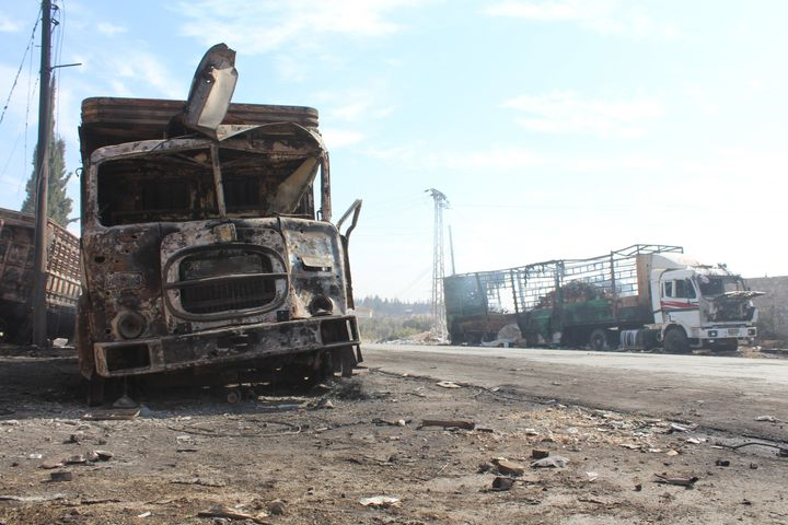 Wreckage of Syrian Red Crescent aid trucks are seen following a Sept. 19 attack killing 12 people in Aleppo.