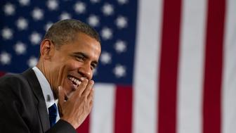 US President Barack Obama laughs before speaking on the economy at the University of Nevada in Las Vegas on July 9, 2010.        AFP PHOTO / Saul LOEB (Photo credit should read SAUL LOEB/AFP/Getty Images)