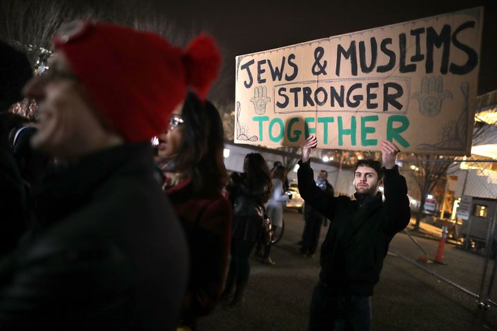 About 60 demonstrators gather outside the White House to protest the anti-Muslim policy proposals of President-elect Donald T