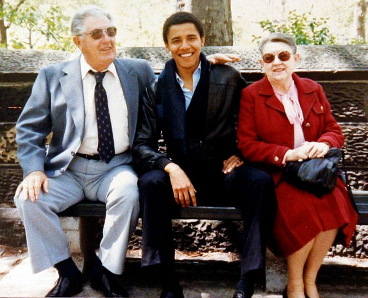 A young Barack Obama sits with his grandparents Stanley and Madelyn Dunham.