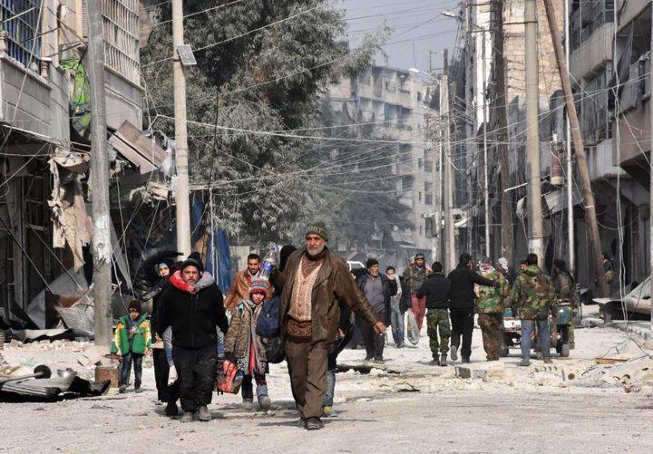 Civilians in Aleppo on Dec. 12.