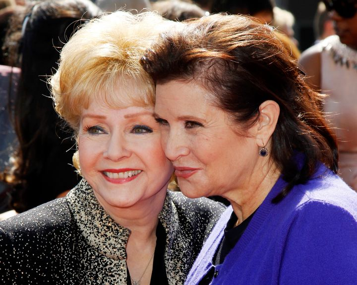 Debbie Reynolds, and her daughter Carrie Fisher, arrive at the 2011 Primetime Creative Arts Emmy Awards in LA, Sept.10,