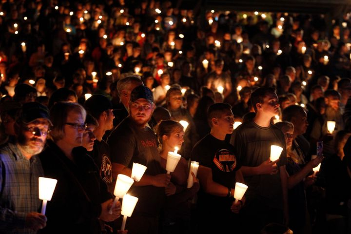 People take part in a candlelight vigil following the mass shooting at Umpqua Community College in Roseburg, Oregon.