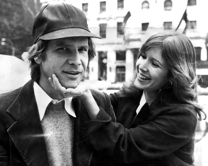 Harrison Ford and Carrie Fisher on Fifth Ave outside The Plaza hotel. They were in town for the movie 'Star Wars.'