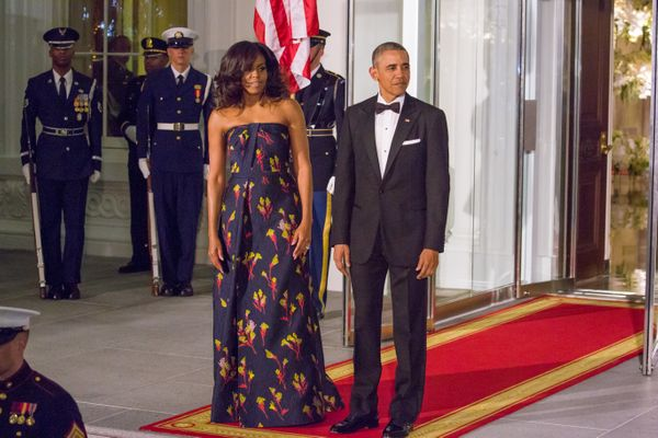 """<a href=""""http://www.huffingtonpost.com/entry/michelle-obama-state-dinner_us_56e1c26ee4b065e2e3d520a3"""">Wearing Jason Wu</a> fo"""