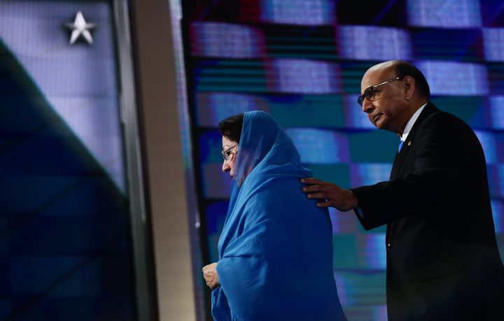 Ghazala Khan (L), accompanied by her husband Khizr Khan (R), walks off stage on the final night of the Democratic National Co