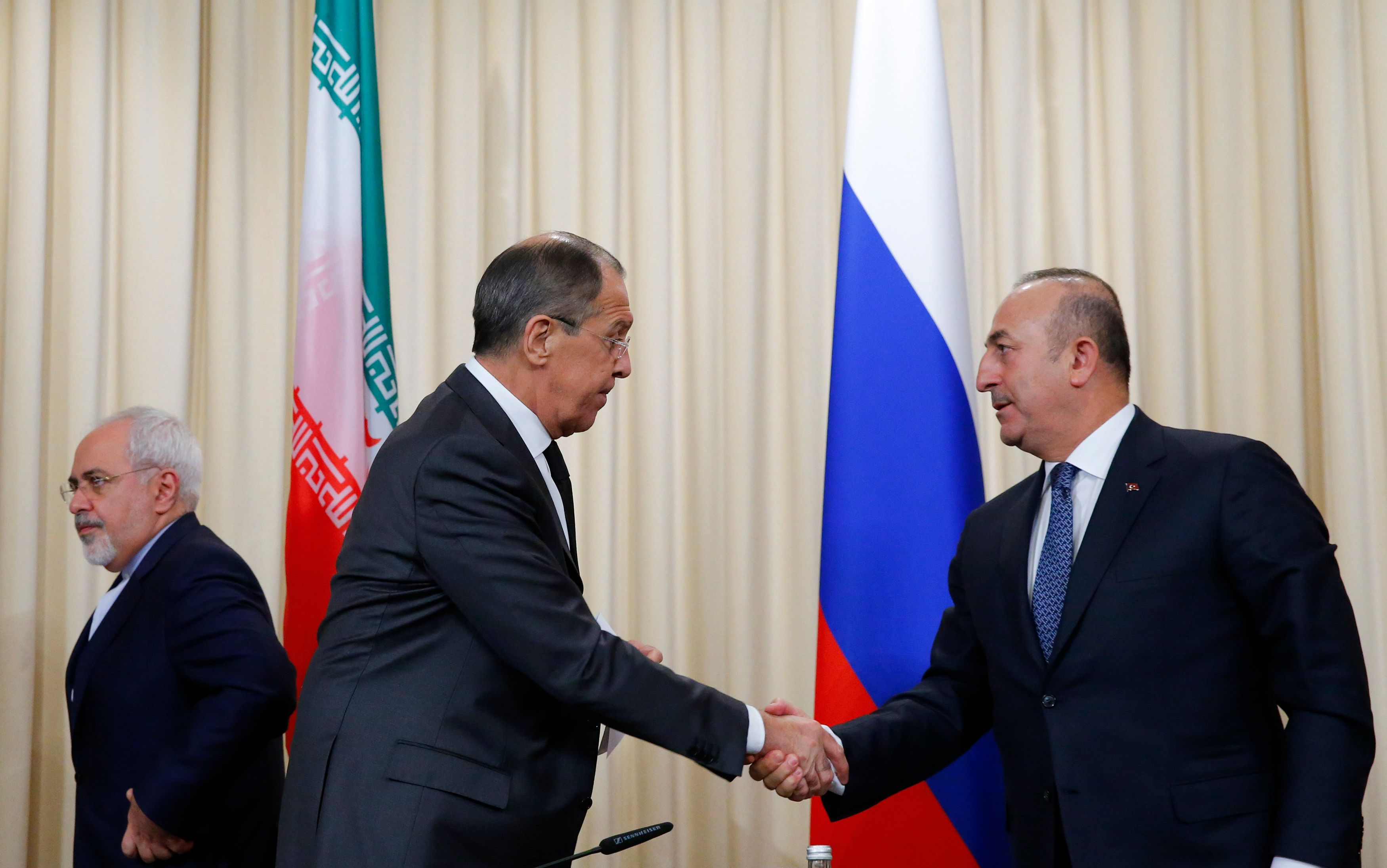 Foreign ministers, Sergei Lavrov, left, of Russia, and Mevlut Cavusoglu, right, of Turkey have reportedly agreed on a pr