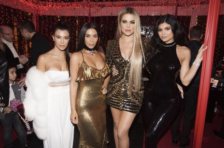 The Kardashian-Jenners' Christmas Party Outfits Are All The NYE Inspo You