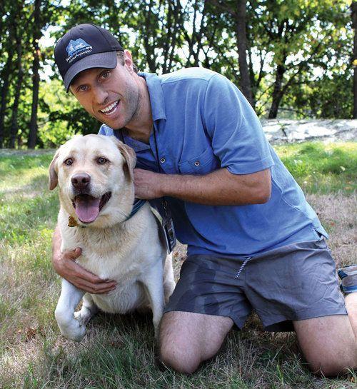 Jordan and his current dog, Kariya, a playful English yellow lab