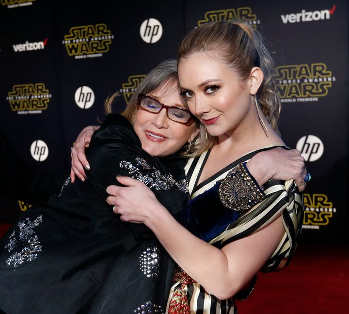 """Carrie Fisher and Billie Lourd embrace as they arrive at the premiere of """"Star Wars: The Force Awakens"""" in Hollywood, CA, Dec"""