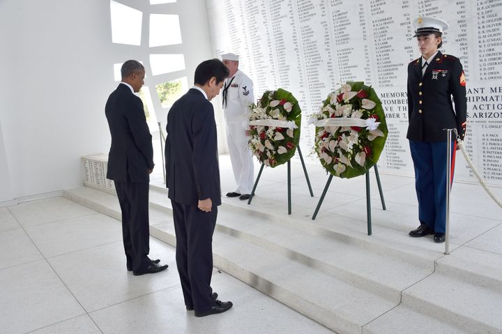 President Barack Obama and Japanese Prime Minister Shinzo Abe place wreaths at the USS Arizona Memorial at Pearl Harbor in Ho