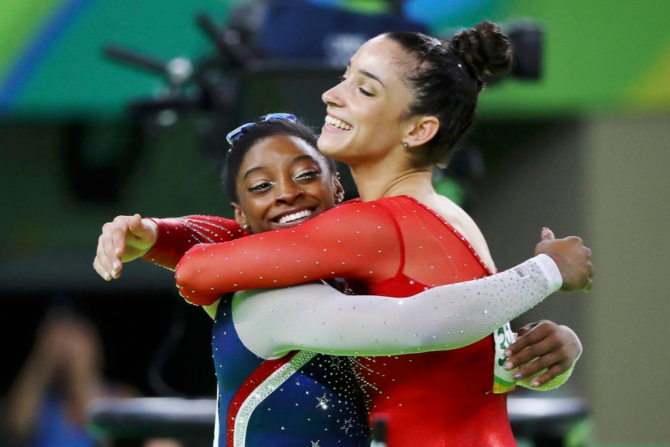 Simone Biles (USA) of USA (L) and Alexandra Raisman (USA) of USA (Aly Raisman) celebrate winning gold and silver respectively