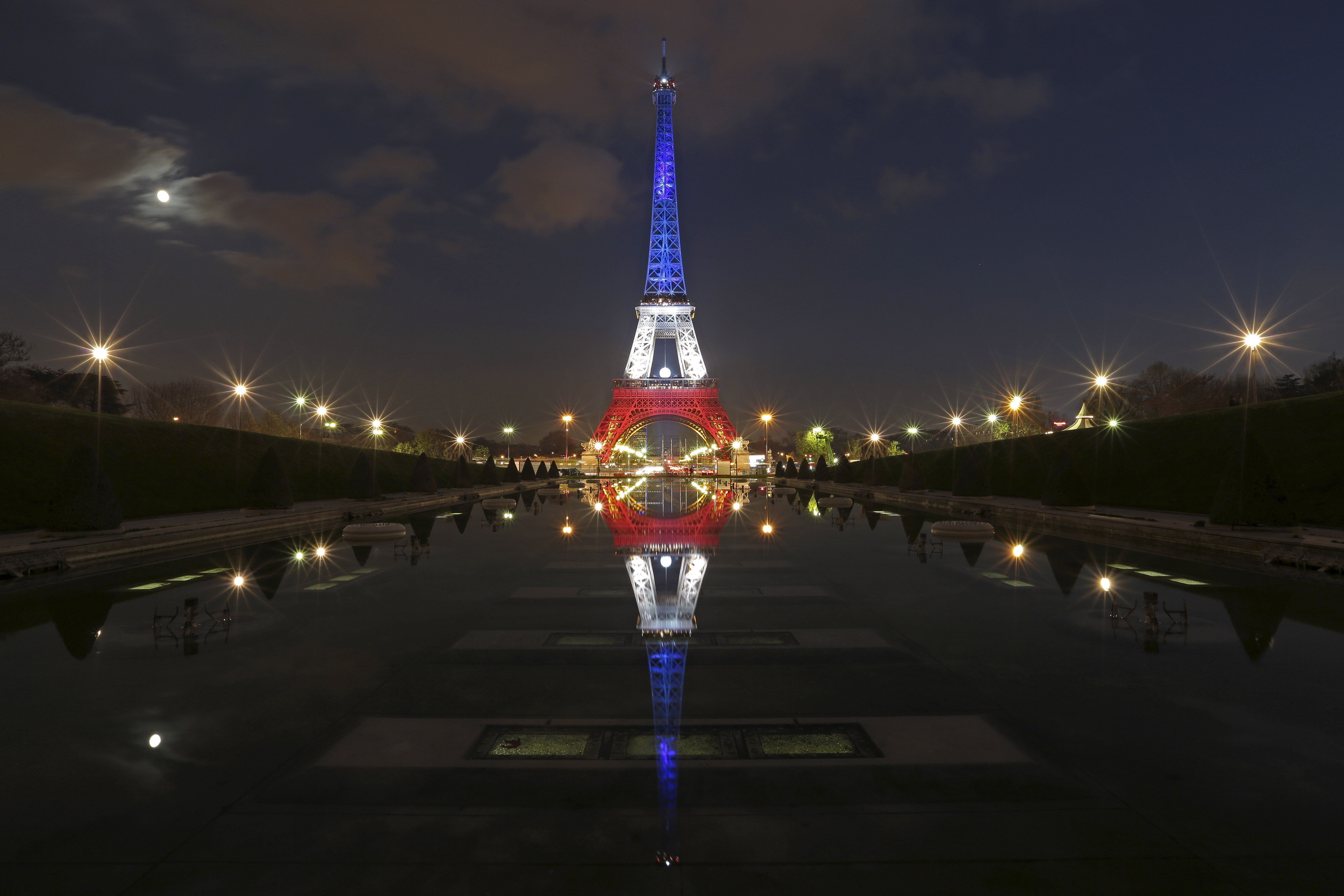 The Eiffel Tower lit with the blue, white and red colors of the French flag onNov. 23, 2015, a week after a series of d