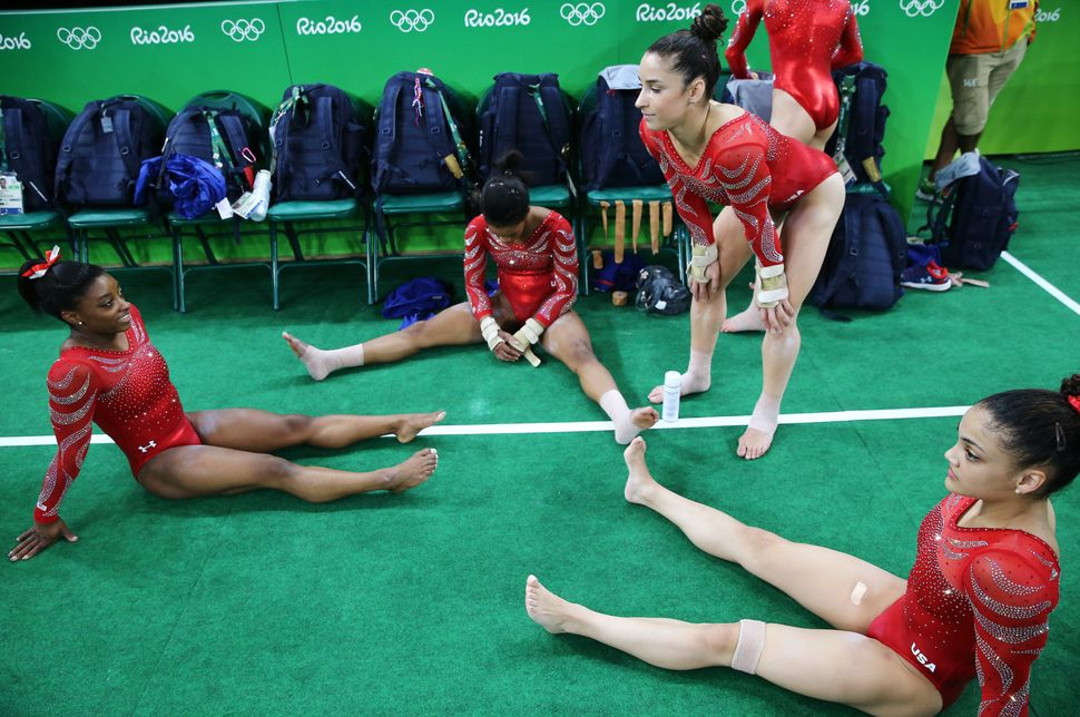 Simone Biles (USA) of USA, Gabrielle Douglas (USA) of USA (Gabby Douglas), Alexandra Raisman (USA) of USA and Laurie Hernande