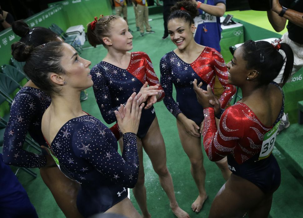 U.S. gymnasts, from left, Aly Raisman, Madison Kocian, Lauren Hernandez and Simone Biles wait for the score during the artist